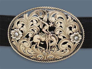 14K gold buckle w/ two 1/4 karat diamonds via Clint Orms, $11600.00